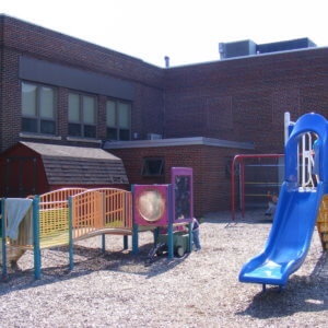 Before photo of the site, showing original play equipment