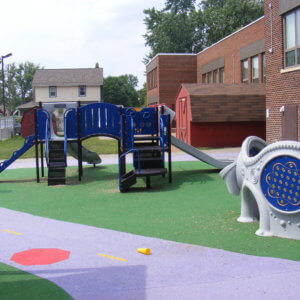 View of main play structure and sensory panel area