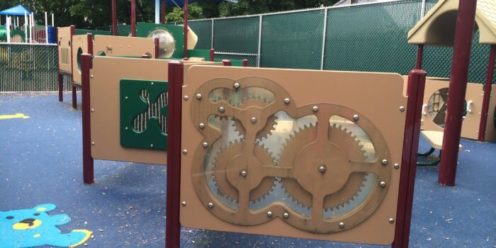 Photo of interactive play panels and playground structures for 2-5 year olds