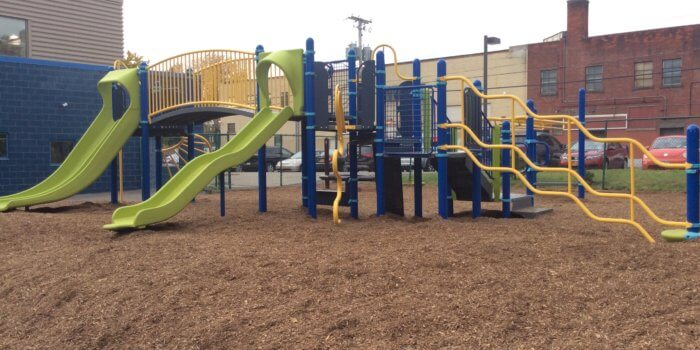 Photo of play structure with multiple slides and climbers