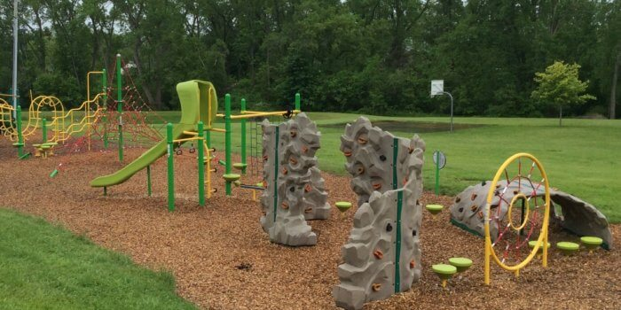 Photo of play structure with climbing walls and slides