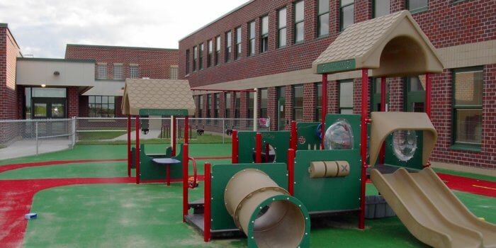 Photo of multiple play structures for 2-5 year olds, with durable carpeting installed as the safety surface