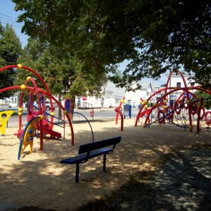 Photo of 2 play arching structures with attached climbers and slides