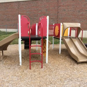 Photo of a play structure for 2-5 year olds with climbers and slides