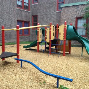 Photo of playground with slides, climbers, and balance beam