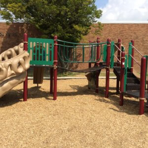 Photo of a playstructure with climbers, a bridge, and a slide