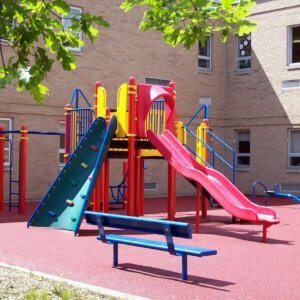 Photo of a play structure with climbers and a slide