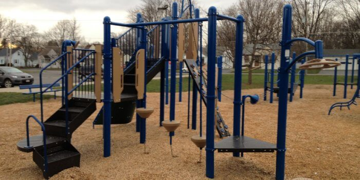 Photo of playground with climbers, step bridges, spinners, and slides.