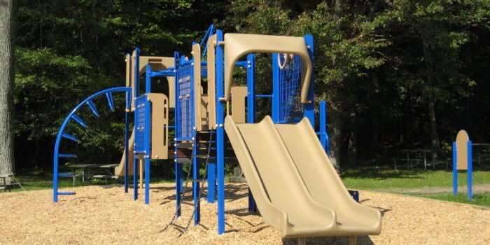 Photo of a multi-deck play structure with slides and climbers