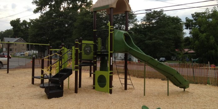 Photo of nature inspired playground with slides, panels, and independent components.