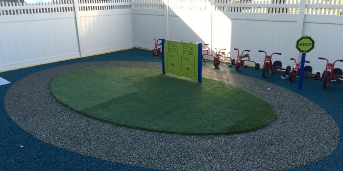 Photo of a tike track with gas station play panel
