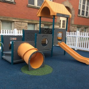 Photo of small play structure with multilevel decks, a tunnel, and a slide