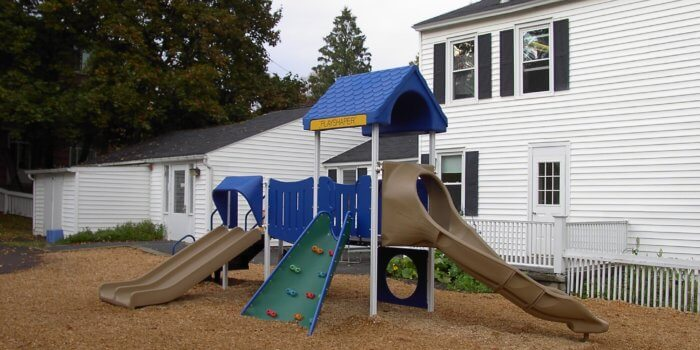 Photo of a play structure for 2-5 year olds with slides and climbers