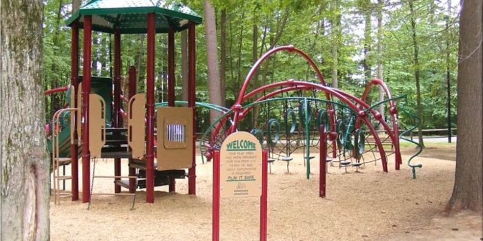 Photo of playground with slides, large decks, and climbing structures.