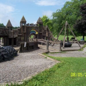 Photo of an older wooden playground
