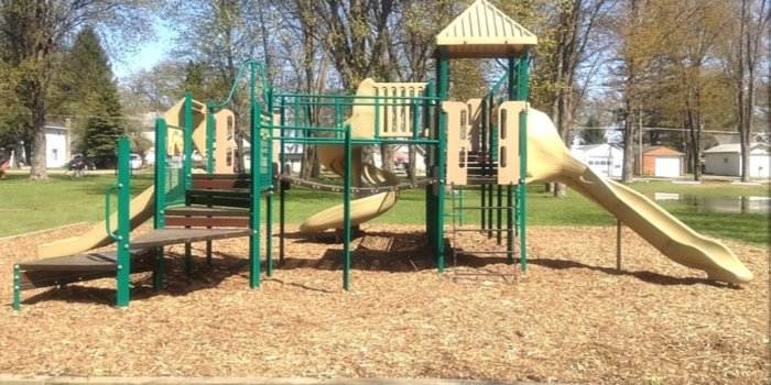 Photo of playground with climbers and slides.