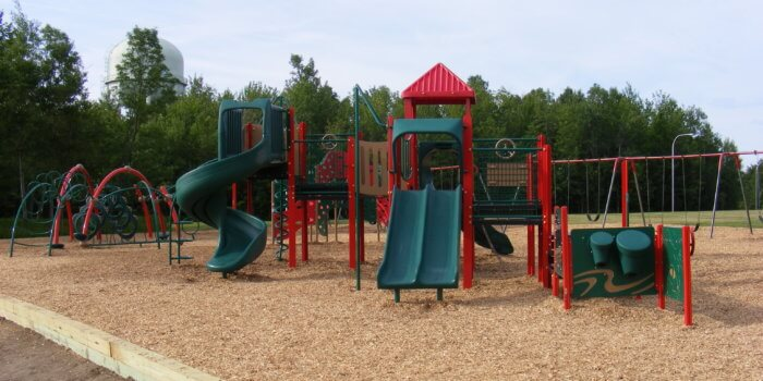 Photo of playground with multiple structures.