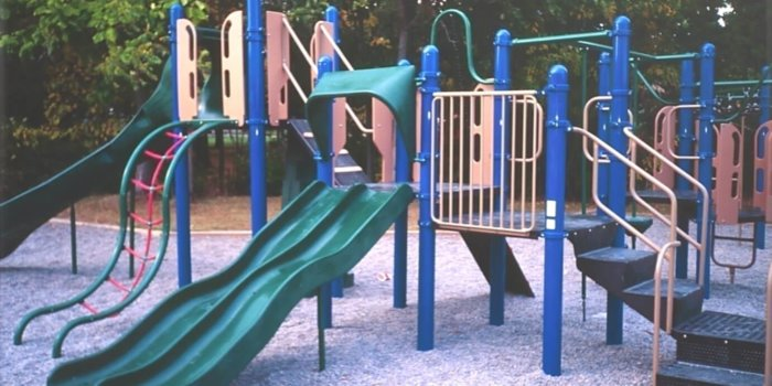 Photo of playground with slides, climbers, and decks.