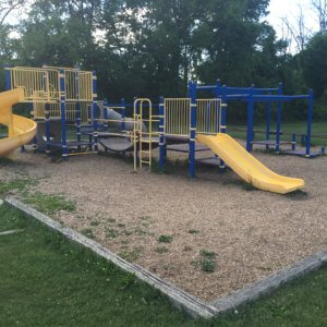 Photo of an old playground with multiple decks and slides
