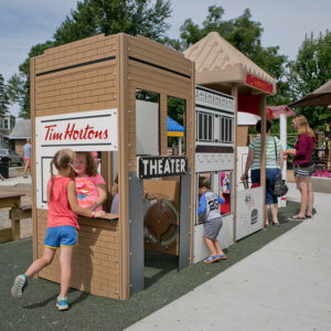 Photo of custom panels and structures, including a theater, a coffee shop counter, and a burger restaurant