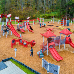 Photo of overall playground site, with play structures and fitness equipment