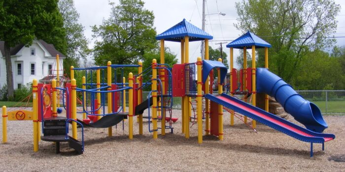 Photo of playground with climbers, slides, and bridges.