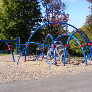 An arched play structure with climbers attached