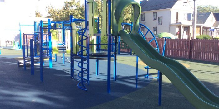 Photo of playground with poured in place surfacing.