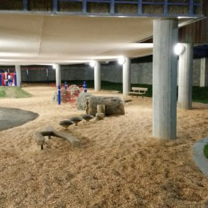View of play area under the school building, illuminated at night