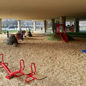 Daytime view of play equipment under the school