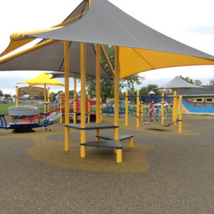 Photo of some of the completed play equipment, focusing on a shade and seating structure