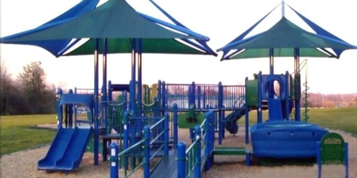 Photo of playground with slides, climbers, ramp, and CoolTopper shades.