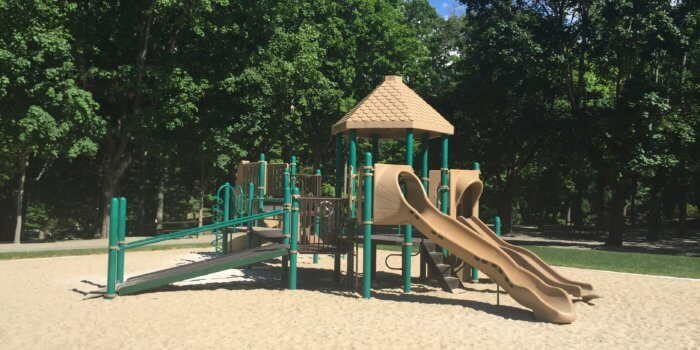 Photo of playground with decks, climbers, and slides.