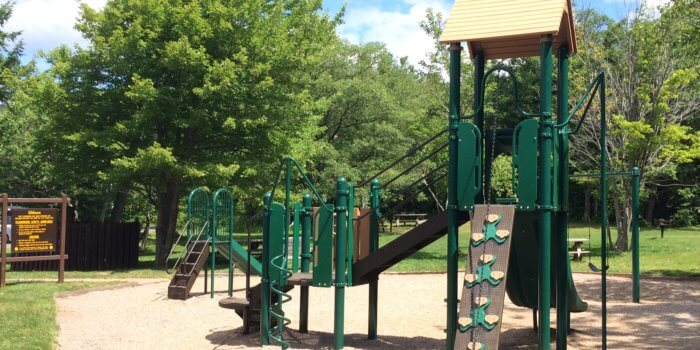 Photo of playground with slides and climbers.