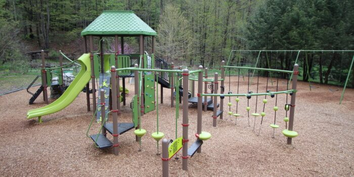 Photo of a playground with climbers, decks, and slides.
