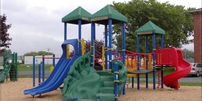 Photo of playground with bridges, slides, roofs, and climbers.