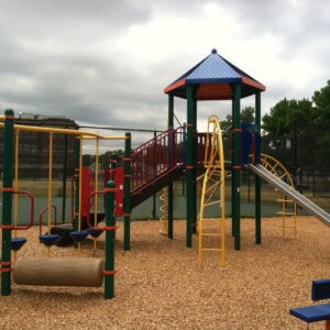 Photo of playground with climbers, step bridge, a slide, and independent components.