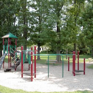 Photo of playground with climbers, slide, and overhead play components.