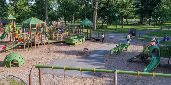 Photo of an expansive playground with slides, swings, bridges, climbers, ramps, and more.