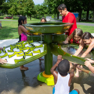 Photo of children playing at a water table.