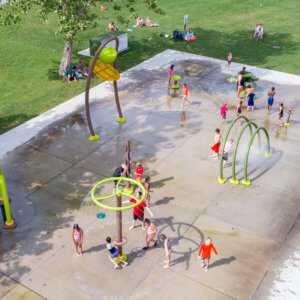 Photo of spray park with water sprinklers, domes, and sprayers.