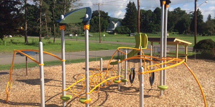 Photo of playground with slide, spinners, and climbers.