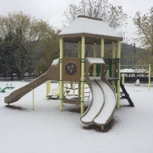 Photo of a smaller play structure for younger children, again taken in the snow