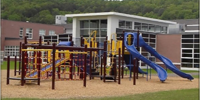 Photo of playground with climbers, slides, and numerous levels of decks.
