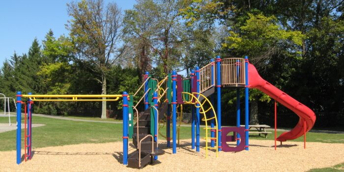 Photo of playground with slide, climbers, and overhead bars