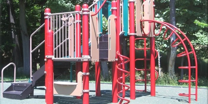 Playground with slides, climbers, and multiple levels of decks.
